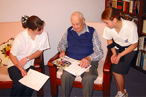 Jaimee Platt and Lexie Carney interview Claude Grimson, WWII veteran, at Burrowa House - Aged Care Facility.